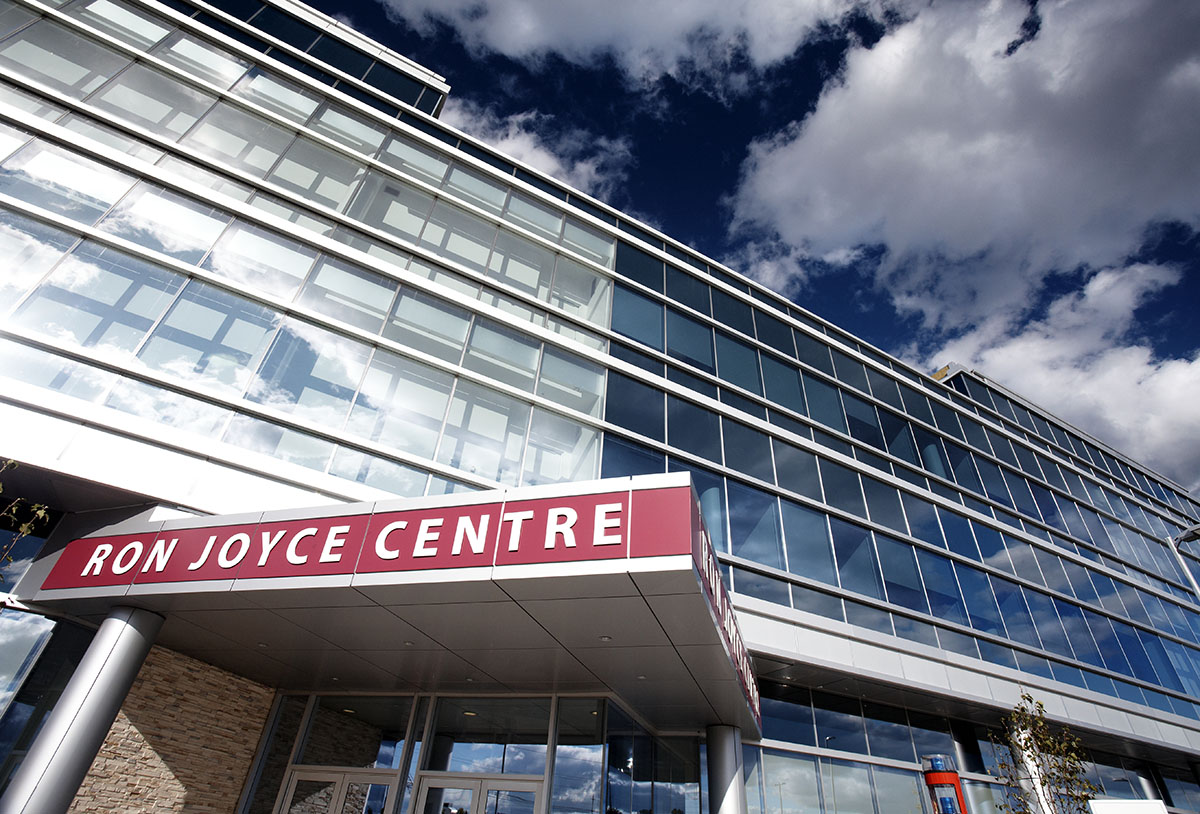 A view of the front door, sign and building that is the Ron Joyce Centre